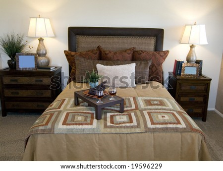 romantic bedroom setting with drink on tray stock photo