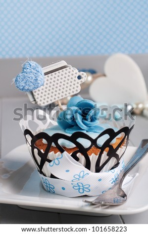 romantic blue flower cupcake with label for your text