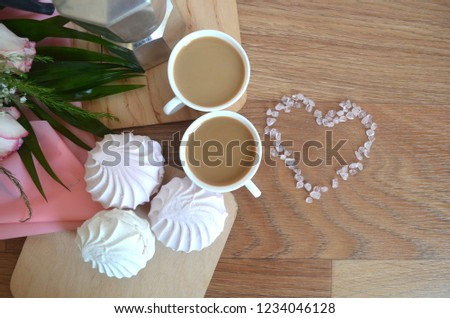 Romantic breakfast for valentines day. Coffee milk two cups marshmallow near heart made out of gems on wooden background. Celebrate love. Romantic concept. Romantic surprise. Romantic morning for her.