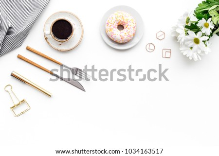 Romantic breakfast with flowers on the table. Coffee with dessert on white background top view copy space