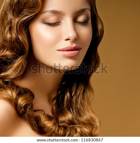 romantic brunette with curly hair