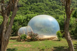 Romantic bubble house with transparent walls. Abstract sci-fi inflatable bubble. Atypical accommodation in exotic tourist destination. Tourist attraction in tropical paradise on Bali island, Indonesia