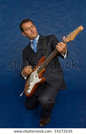 romantic businessman with guitar over blue
