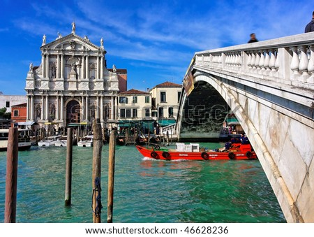 Romantic canal in center of Venice. Rialto Bridge.