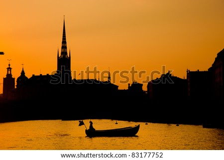 Romantic city of Stockholm, Sweden at sunset. Boat and architecture