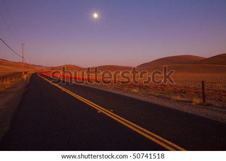 Romantic country road at dusk
