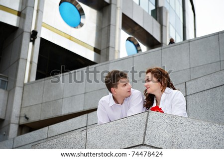 Romantic couple about a modern building in the city - stock photo