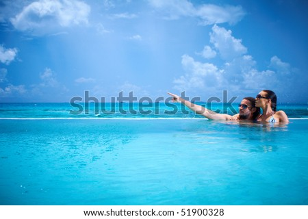 Romantic Couple Alone In Infinity Swimming Pool Stock Photo 51900328 Shutterstock