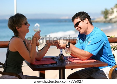 Romantic couple at a seaside cafe
