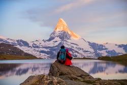 Romantic couple at sunrise, from lake Stellisee, Swiss Alps , Matterhorn Peak, Zermatt,