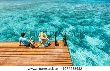 Romantic couple at tropical resort during honeymoon vacation
