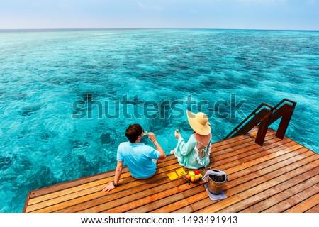 Romantic couple at tropical resort during honeymoon vacation