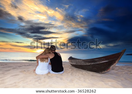 Romantic couple at uninhabited island at sunset time