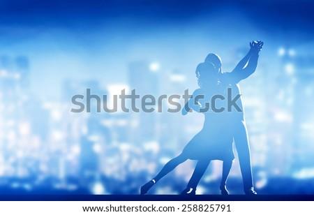 Romantic couple dance. Elegant classic pose. City nightlife background