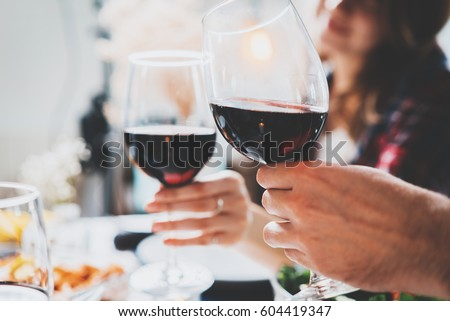 Romantic couple enjoying dinner at home, concept love, relationship and romantic, happy couple celebrating and making cheers with glasses of red wine #604419347