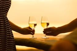 Romantic couple enjoying wine by the sea