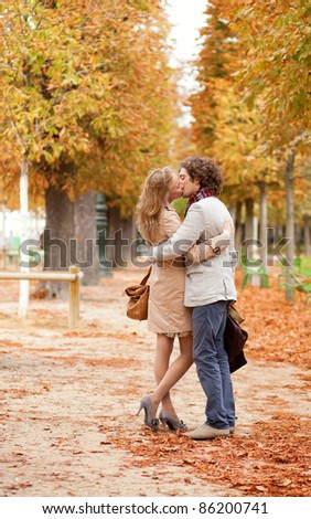Romantic couple having a date in the Tuilleries garden of Paris