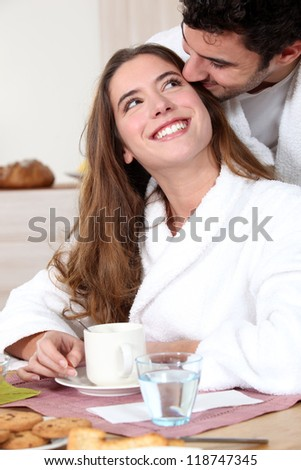 Romantic couple having breakfast together