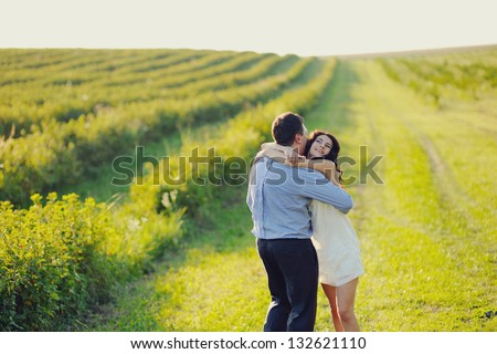 romantic couple having fun in the field