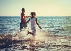 Romantic couple having fun on the beach