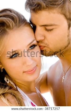 Romantic couple having fun on the seaside - stock photo