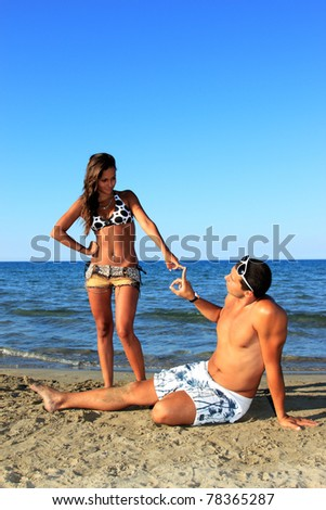 Romantic couple having fun on the seaside