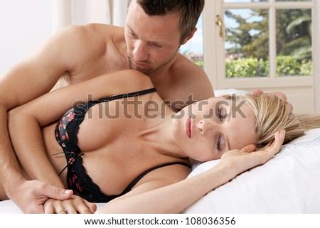 Romantic couple in bed.