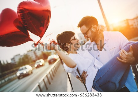 Romantic couple in love dating and smiling in sunset outdoor #636283433