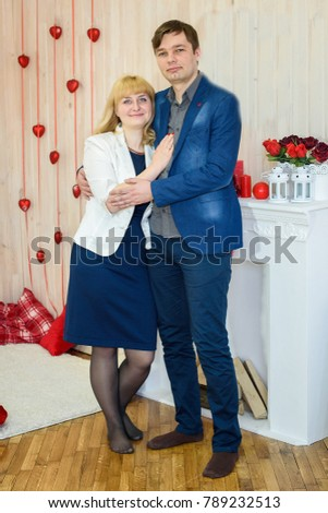romantic couple in love in a room decorated with red hearts for Valentine's Day #789232513