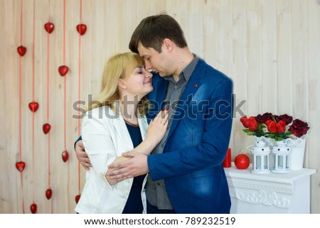 romantic couple in love in a room decorated with red hearts for Valentine's Day #789232519