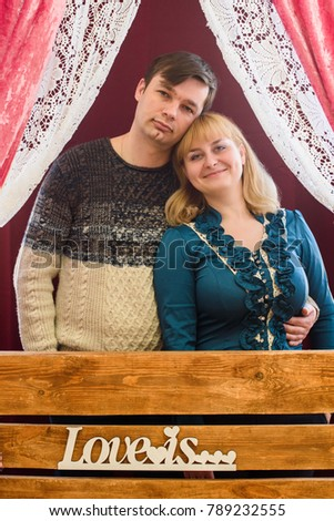 romantic couple in love in a room decorated with red hearts for Valentine's Day #789232555