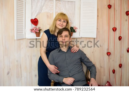 romantic couple in love in a room decorated with red hearts for Valentine's Day #789232564