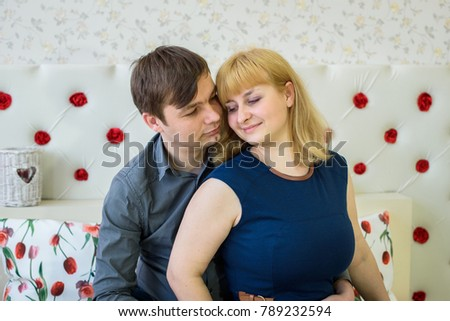 romantic couple in love in a room decorated with red hearts for Valentine's Day #789232594