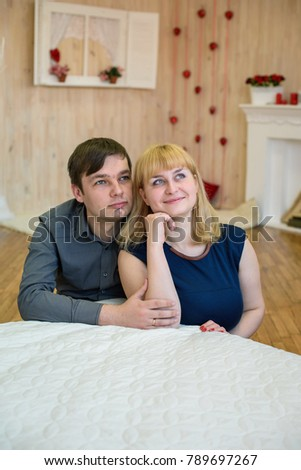 romantic couple in love in a room decorated with red hearts for Valentine's Day #789697267