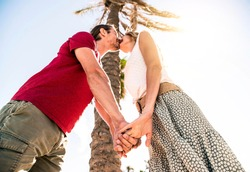 Romantic couple in love kissing on tropical island vacation - Young lovers in honeymoon having holidays on exotic beach - People, love and honeymoon tour packages