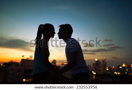 Romantic couple kissing in the city