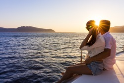 Romantic couple on yacht at sunset