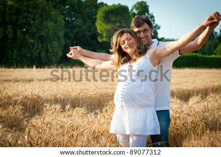 Romantic couple portrait in a wheat field.