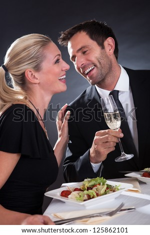 Romantic couple sitting having dinner in an elegant restaurant
