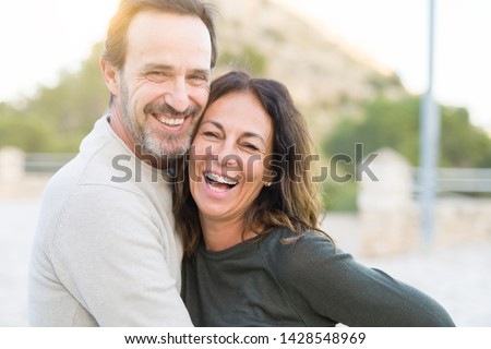 Romantic couple smiling and cuddling on a sunny day #1428548969