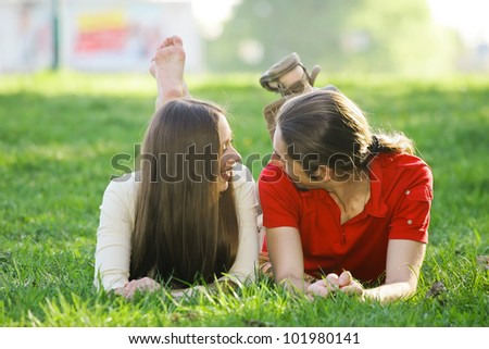 Romantic couple spending time together in the summer park - stock photo