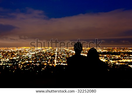 Romantic couple takes in the view the city lights