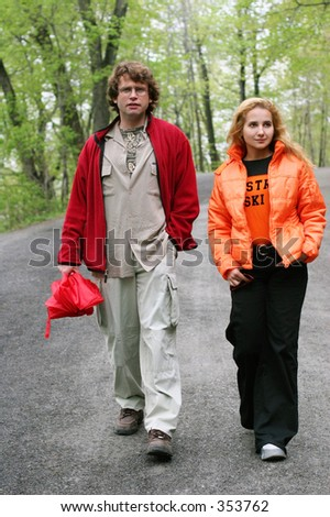 Romantic couple walking in a park. - stock photo
