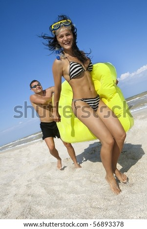 Romantic couple with an inflatable beach mattress