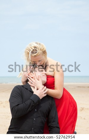 Romantic couple with woman making the advances