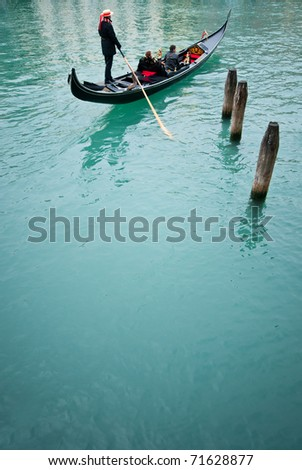Romantic cruise in gondola in the canal of Venice - stock photo