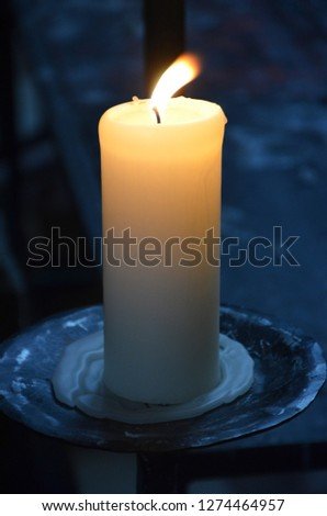 romantic dark candle, yellow blue, scary dark  flame Zdjęcia stock ©