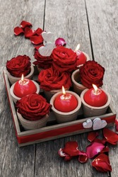 Romantic decoration with roses and scented candles in wooden box. Decoration for Valentines day. Easy and cheap home decor.