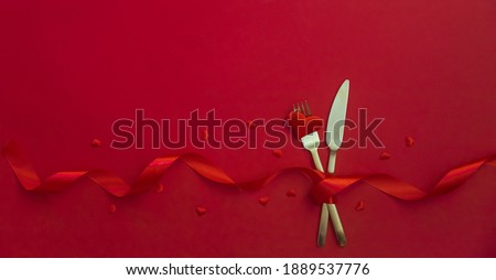 Romantic dinner for Valentine's day on a red background. Selective focus. Holiday. Stock photo ©
