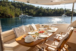 Romantic Dinner on Motor Yacht at Sunset, Table Setting at a Luxury Yacht.